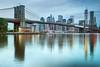 The Brooklyn Bridge (mudpig) Tags: nyc newyorkcity longexposure cloud reflection skyline brooklyn sunrise geotagged mirror downtown cityscape manhattan dumbo carousel calm financialdistrict southstreetseaport brooklynbridge eastriver gothamist hdr brooklynbridgepark mudpig stevekelley