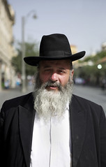 (Caitlin H. Faw) Tags: street light shadow portrait man color hat june standing canon mouth beard eos israel eyes jerusalem suit jacket 5d yosef jaffaroad yerushalayim markiii 2013 caitlinfaw caitlinfawphotography