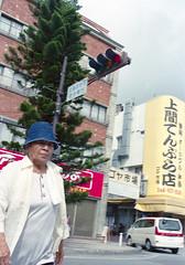 ゲート通り 横断歩道を渡るひと Okinawa-si, Okinawa (ymtrx79g ( Activity stop)) Tags: street color slr film japan analog nikon kodak 35mmfilm okinawa 135 沖縄 街 写真 銀塩 フィルム nikonnewfm2 沖縄市 kodakultramax400 nikonainikkor35mmf2 歩行走行 walkandrun 201310blog okinawasi