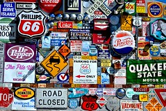 Wall on Route 66 (Len Radin) Tags: hardhat signs ford mobile keys route66 gm gulf elvis albuquerque drpepper mission pepsicola roadsigns locust toms squirt yield milkshake ge childrenatplay sh explosives folgers noloitering phillips66 towaway daytona500 valvoline quakerstate pennzoil 66diner fulf greenstamps shgreenstamps missionbeverages uniteddelco