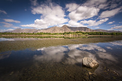The amazing scenery in Tibet (Tim van Woensel) Tags: tibet travel asia water reflection tagtse lhasa clouds sky mountains kyichu rock long exposure color colors river dagze county himalayas himalaya rocks tree trees high altitude