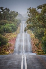 shadows in the rain (freakingrabbit) Tags: red center rain australia northern territory mc donell range west mac national park namatjira drive street wet pastel color colors straight subject flooding