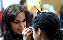 Face Painting (Poocher7) Tags: makeup facepainting girl younglady prettywoman darkhair cutegirl braids sponge paintbrushes fun candid people portrait sunlight smile