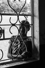 Alone (Natalia Lozano) Tags: portrait retrato retratos window woman girl bn bw blancoynegro bnw kenya maramba monochrome monocromático monócromo