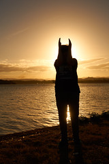 Batboy (RobMacPhotography) Tags: people silhouette water sunset lake river reflection canberra act australia golden batman sony a6000 rob mac photography burley griffin ripples mountains clouds sky
