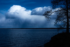 Dark sides of the lake (Joni Mansikka) Tags: spring nature outdoor lake lakeside trees silhouettes dark water blues clouds landscape pyhäjärvi yläne suomi suomi100 finland finland100 sky