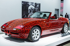 Keith Haring BMW (Thad Zajdowicz) Tags: zajdowicz losangeles california petersenautomotivemuseum availablelight indoor inside museum canon eos 5dmarkiii 5d3 dslr digital lightroom ef50mmf12lusm 50mm primelens car automobile convertible color red bmw artkeithharing artist colour wheels