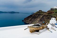 Santorini (Manos Kour) Tags: boat old santorini volcano vacation april roof water ocean sky kaldera fira greece woody wooden white