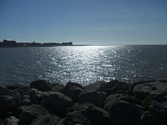 View from the Stone Jetty in Morecambe (Bennydorm) Tags: sunlight april fujifinepix breakwater shimmering skyline europe uk gb britain sky england resort coast view blue lancashire tide seaside stones jetty morecambe morecambebay water sea