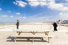 Just the two of us... (Ania Liesting   anialiesting.com) Tags: coast clouds sky wood beach strand twopeople pier scheveningen