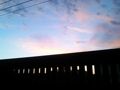Dusk. (Explored - April 26, 2017) (Somersaulting Giraffe) Tags: outdoor gate porch evening clouds sky blue orange dusk twilight theview beautifultoday purple white spring departure garage ngc light