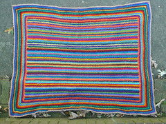 An overview of the striped scrap crochet afghan I made for my youngest son (crochetbug13) Tags: crochet crocheted crocheting crochetrectangle singlecrochet scrapcrochet crochetstripes crochetafghan crochetblanket crochetthrow