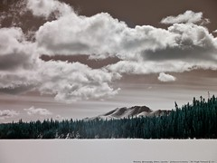 Little Peak Mountain - 665nm Infrared (MIKOFOX ⌘ Show Your EXIF!) Tags: canada clouds infrared infraredconversion yukon lake march mountain snow panasoniclumixgx1 learnfromexif spruce fullspectrumconversion gx1 665nm winter mikofox showyourexif lumixgvario1445f3556