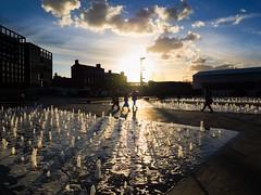 ** (donvucl) Tags: london granarysquare sky clouds colour shadows reflections fountain figures buildings urban olympusem1 donvucl