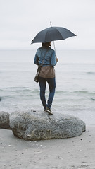 staring at the sea (2) (lennstr) Tags: ocean sea woman beach girl weather strand umbrella deutschland scenery meer view horizon rgen horizont binz melancholic regenschirm xpro1 fujixpro1 fujinonxf35mmf14r