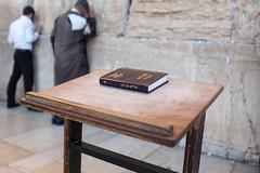 Book stand (diggertomsen) Tags: travel wall israel palestine jerusalem religion holy western fujifilm judaism fujinon prayers wailing x100s