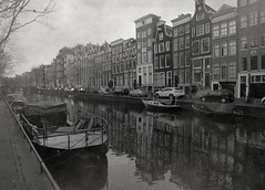 Amsterdam Fog (JML78) Tags: street city travel cruise windows summer bw white house black holland building tree brick history cars tourism water netherlands dutch car amsterdam bicycle fog stone architecture facade port river landscape boats boat canal ancient streetlight europe downtown pattern cityscape exterior waterfront view place apartment unique district lodging traditional famous capital transport landmark structure historic sidewalk age transportation destination docklands autos viewpoint rowhouse vision:mountain=0513 vision:outdoor=0891