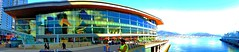 Pano: Vancouver Convention Centre (peggyhr) Tags: ocean blue light red sky people orange brown sunlight white canada black green glass yellow vancouver clouds reflections shadows bc railing umbrellas canadaplace ye thegalaxy vancouverconventioncentre peggyhr fairmontwaterfronthotel mygearandme redgroupno1 portmentrovancouver yellowlevelno2 ♣myhatsofftoyou ♣scapes lebenmitmultiplesklerosems infinitexposurel1 ted2014conference norhshoremountains p1070832axy architecturalfavourites