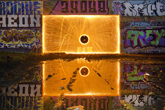 Square Root. (Sean Hartwell Photography) Tags: wirewool flame sparks square circle geometry urban graffiti grit water puddle reflection uxbridge london westlondon a40 flyover concrete decay