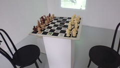 'Attacking The Adjudication' installation. (Beth sullivan fine art) Tags: blackand white black chess attacking adjudication racism race family background identity history battle installation exhibition neighbourhood chocolate projection chairs clay