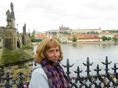 Carolyn, love locks, the Charles Bridge, swans on the Vltava River and the Prague Castle (jimsawthat) Tags: carolyn locks lovelocks bridge charlesbridge river vltavariver swans birds urban tradition czechrepublic prague