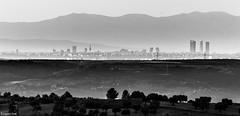 Madrid. (Eugercios) Tags: madrid skyline skyscrapers sky rascacielos arranhacéus arquitectura architecture landscape cityscape ciudad city cidade montaña bw white black preto branco negro blanco far chinchon