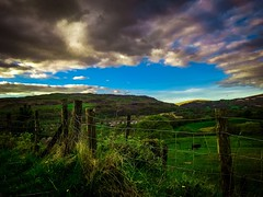 Clouds rolling in (Rae de Galles) Tags: wildlife colours beautiful breconbeacons brecon beacons blue storm rolling purple skies sky grass horse field green clouds cloud
