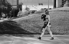 All Star (burnt dirt) Tags: houston texas downtown city town mainstreet street sidewalk streetphotography fujifilm xt1 bw blackandwhite girl woman people person animae cosplay costume uniform matsuri convention walking star stockings whitestockings headphones cheerleader purse bag chucktaylors kneehigh gloves whitegloves harleyquinn discoverygreen georgerbrown