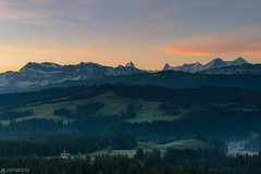Sunrise - Chuderhüsi (Captures.ch) Tags: 2017 black blue brown buildings chuderhüsi church clouds dawn eiger emmental forest gray green hills hohgant landscape mönch morning mountains nature orange perfect red sky spring sunrise swiss switzerland trees white würzbrunnen ngc