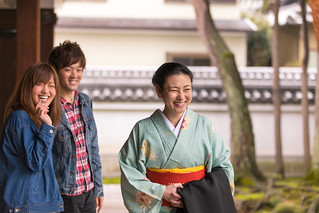 Woman in Kimono and young couple at temple garden