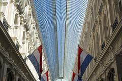 Today King's day in the Netherlands (Jan van der Wolf) Tags: map15578v symmetric symmetry denhaag passage vlag vlaggen flags dutch nederland nederlands glass glas ceiling koningsdag lines lijnen