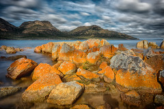 Coles Bay (Elephas_a) Tags: australia colesbay freycinet ndfilter pacificocean tasmania autumn bay beach blue clouds coast coastline fall landscape lichens longexposure mountains movingwater ocean orange peaceful sea seascape serene sky tranquil water waterscape