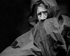 Protected (Jochen-B) Tags: street old bw woman white black monochrome rain lady candid olympus protection 45mm omd em5 4518