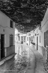 Setinel de Bodegas (WildVanilla (Rob)) Tags: houses blackandwhite bw cliff monochrome buildings andaluca spain village andalusia cliffside setineldebodegas
