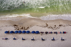 Early morning beach set-up (ryotnlpm) Tags: ocean morning sea vacation beach umbrella relax chair gulf florida relaxing symmetry paddleboard suf