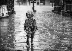 Girl in rain (DavidWinshipPhotography) Tags: life street city people blackandwhite bw art girl rain real photography town child arty small gritty rainy