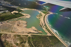 DSC_3830 [ps] - This Could Be Rotterdam (Anyhoo) Tags: sea beach water pool grass bay coast rainbow view transport flight wing sydney australia lagoon sediment shore nsw newsouthwales fromtheair reclamation fromtheplane infill spoil landreclamation longshoredrift viewfromtheplane reclaimedland anyhoo photobyanyhoo polarisingrainbow