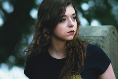 Untitled (Katherine Lind Photography) Tags: trees light portrait woman brown color cute green nature girl beautiful face grave graveyard youth hair eyes pretty sweet bokeh vibrant gorgeous breath longhair greeneyes messy gravestone brunette breathe curlyhair brownhair magentalipstick