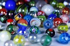 (Flavio Calcagnini) Tags: glass marble marbles biglie biglia colori color blu yellow giallo blue green red verde rosso nero dark flavio calcagnini vortex galaxy