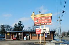 Stateline Liquors, South Beloit Illinois (Cragin Spring) Tags: midwest building sign unitedstates usa unitedstatesofamerica liquorstore liquors liquor arrowsign arrow stateline statelineliquors southbeloit southbeloitil southbeloitillinois