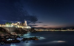 Antibes by night ..... ( French Riviera / France ) (AzurScape) Tags: france frenchriviera cotedazur alpesmaritimes antibes oldtown city landscape seascape cityscape evening night light stars sky sea rock canon longexposure clouds town paysage ville