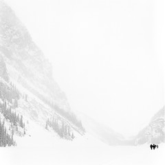 Little people, big mountains (Zeb Andrews) Tags: canadianrockies lakelouise banff film mediumformat hasselblad500c kodaktrix blackwhite alberta canada 6x6 monochrome winter whiteout frozen scale mountains filmisnotdead