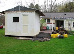 THE WORKSHOP SOFAR (richie 59) Tags: ulstercountyny ulstercounty newyorkstate newyork unitedstates trees townofesopusny townofesopus richie59 stremyny stremy outside backyard grass yard neighborhood patio home shed woodenshed 2017 workshop april2017 april222017 2010s america hudsonvalley midhudsonvalley midhudson nystate nys ny usa us constructionsite constructionarea plywoodbuilding building house pavers buckets