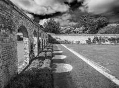 The Walled Garden (Jon and Sian Bishop) Tags: highclere castle newbury england uk europe spring april 2017 canon eos 6d jon bishop photography outdoor landscape wall arch shadow blackandwhite black white monochrome showdows arches lines thirds leading