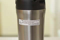 warning sticker on a travel coffee mug/bottle (yourbestdigs) Tags: water bottle travel mug coffee thermos hot drink drinks beverage bottles mugs office leak stainless steel insulated warm liquid food lid lids tea hydration morning breakfast drinking exercising