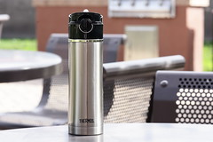 Thermos Drink stainless steel mug/bottle on park table (yourbestdigs) Tags: water bottle travel mug coffee thermos hot drink drinks beverage bottles mugs office leak stainless steel insulated warm liquid food lid lids tea hydration morning breakfast drinking exercising