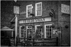 The Swan Pub (mattpacker1978) Tags: blackandwhite black nocolour nocolor monochrome pub public house ale beer drinks good times canon 1855mm dslr digital village booze eyes guinness swan ye old bricks home fun out lively bands highstreet sign cask benches fences windows