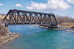 Spring coloured river (jmschrei) Tags: alberta bowriver bowmontpark bridge calgary clouds da35ltd k5 landscape pentax river sky