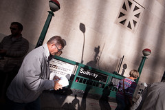 [ reading lamp ] ([ changó ]) Tags: newyork statiuniti wwwriccardoromanocom subway metro metropolitana shadow ombra ombre sombra shade people person persona gente persone street shot streetshot nyc newyorkcity lamp read reading leggere lettura