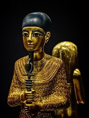 Closeup of Gilded wood figure of the god Ptah New Kingdom 18th Dynasty Egypt 1332-1323 BCE (mharrsch) Tags: figure figurine sculpture god deity ptah statue pharaoh king ruler tutankhamun burial tomb funerary 18thdynasty newkingdom egypt 14thcenturybce ancient discoveryofkingtut exhibit newyork mharrsch premierexhibits gold